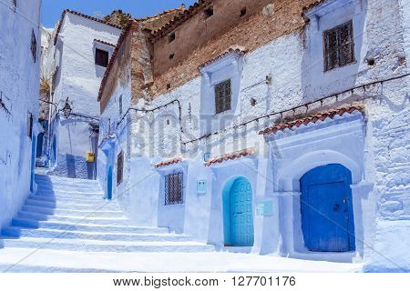 Stairway in the blue medina of Chefchaouen Morocco poster