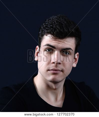 charismatic young man portrait with a hard light