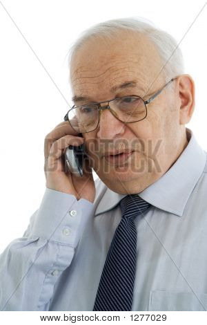 Mature Businessman Talking On His Cell Phone