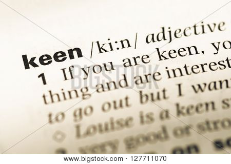 Close Up Of Old English Dictionary Page With Word Keen.