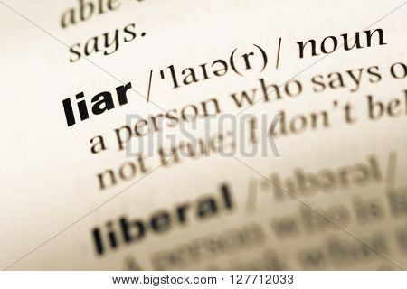 Close Up Of Old English Dictionary Page With Word Liar.