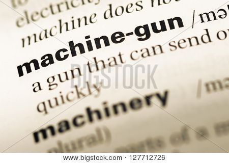 Close Up Of Old English Dictionary Page With Word Machine Gun.