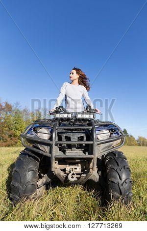 Elegant Woman Riding Extreme Quadrocycle Atv