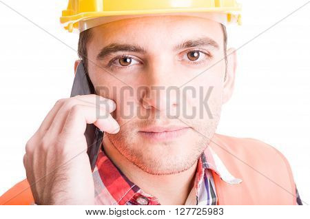 Modern constructor talking on his smartphone. Face closeup concept