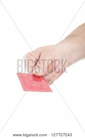 Male hand holding and handing a condom isolated on white background