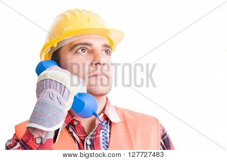 Visionary And Confident Builder Using Phone
