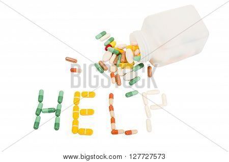 Help word made from various pills on white background. Overdose abuse or addiction concept