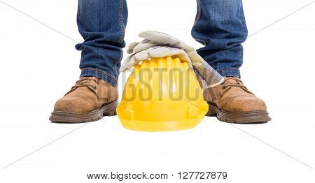 Construction builder feet helmet and gloves. Wide picture isolated on white background