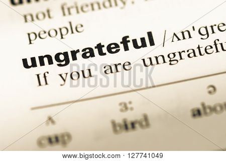 Close Up Of Old English Dictionary Page With Word Ungrateful.