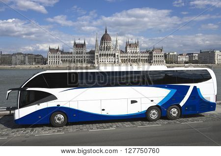 BUDAPEST, HUNGARY - APRIL 04, 2015: Hungarian Parliament Building and in foreground a modern two level  tourist bus