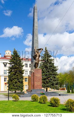 GOMEL BELARUS - APRIL 23 2016: Monument to members of the Komsomol - underground fighters at the intersection of Streets of Karpovich and Zharkovskogo Gomel Belarus