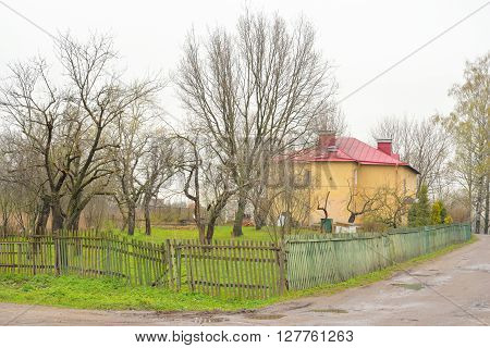 Rural landscape in village Ust Slav at spring cloud day.