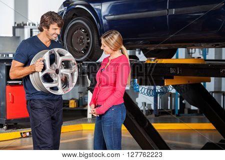 Mechanic Explaining Alloy To Customer