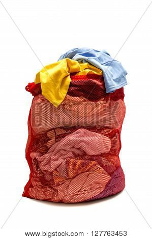 Overstuffed  red mesh laundry bag full of clothes. Isolated on white.