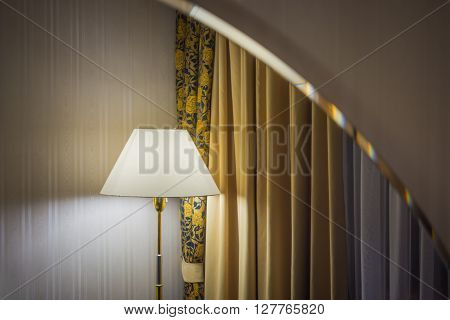 Reflection of lamp and curtains in the mirror