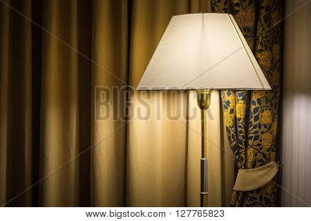 Old lamp and curtains in the hotel room