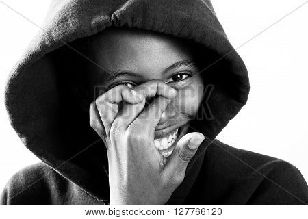 smiling boy in hoodie with face partially covered