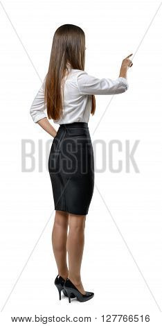 Cutout businesswoman in an office dress imitates the touch to something. Learning and cognition. Success and development. Business staff. Office clothes. Dress code. Presentable appearance. Beauty and youth.
