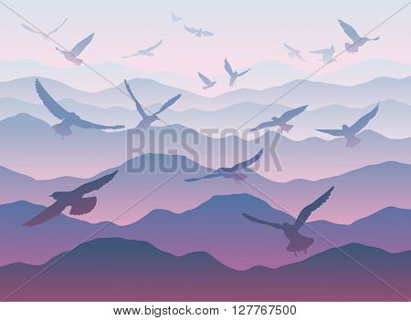 Silhouettes Of Flying Birds Over Mountains