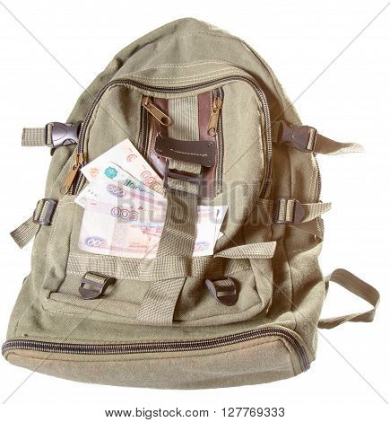 Backpack and several notes of Russian rubles. A backpack of color khaki it is isolated on a white background a close up