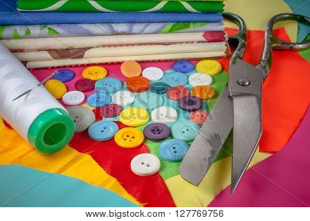 background with sewing accessories, with colored chintz, buttons, shears, set for needlework