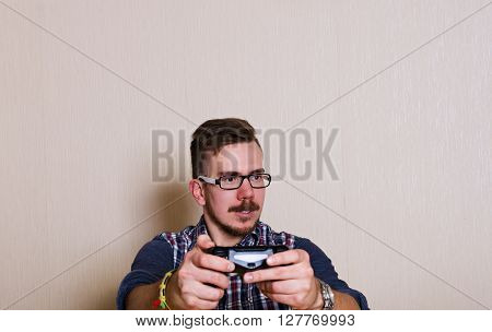 bespectacled man playing a video game. a man without emotions