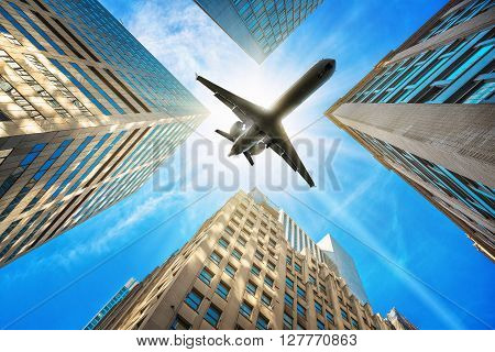 picture of a airplane over skyscrapers of new york