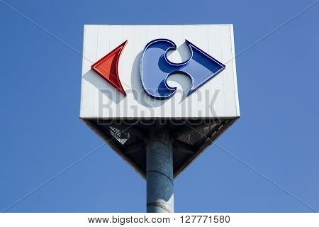 Macon, France - September 21, 2015: Carrefour sign on a pole. Carrefour is a french multinational retailer headquartered in France and it is one of the largest hypermarket chains in the world