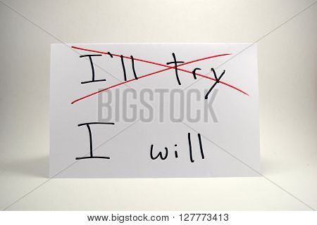 """A motivational concept of perseverance and determination. The emphasis on the paper is put on saying """"I will"""" instead of """"I'll try"""". poster"""