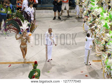 Rio de Janeiro Brazil - February 23: amazing extravaganza during the annual Carnival in Rio de Janeiro on February 23 2009 - semi naked female dancer with her entourage