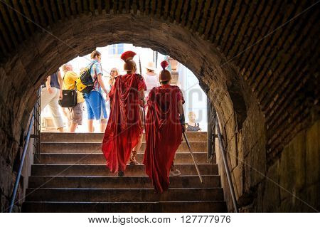 SPLIT CROATIA - SEPTEMBER 2 2009: Roman soldiers walking out to the east side of the Peristyle under the Prothyron