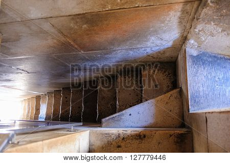 Narrow staircase which leads up to St. Domnius bell tower at Split, Croatia poster