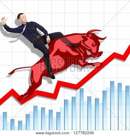 Businessman is on the jumping red bull on red arrow downward trend line on background of  graphic of  fund. Fight back bullish market concept.