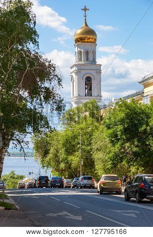 SAMARA RUSSIA - JUNE 12 2015: View on belltower of Iversky monastery and Volga river in summer sunny day