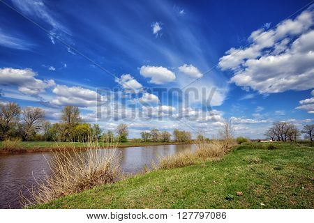 Spring landscape with river and blue sky