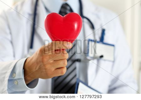 Male Medicine Doctor Hands Holding Red Toy Heart