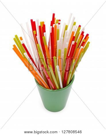 Straws for drinks in the glass. The photo on white background