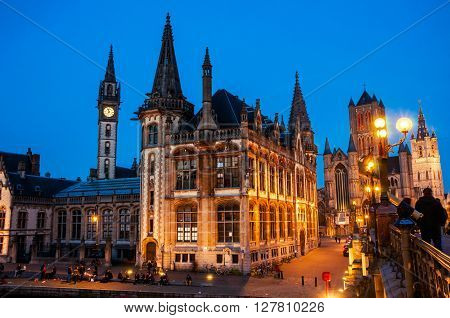 Ghent in Belgium at night. Medieval old part of the famous Flemish city which is held well preserved. Sant - Nicholas Church, bridge and The Graslei area.