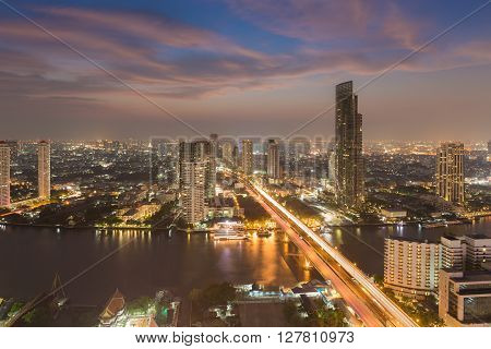 Aerial view Bangkok city downtown with river curved night view, Thailand