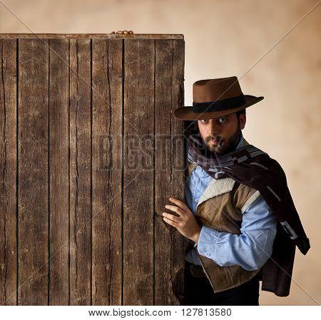 Gunfighter Near Wooden Blank Table.