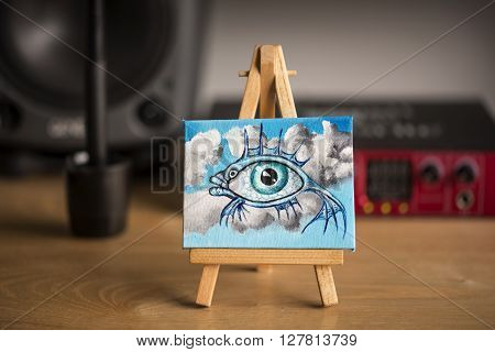 Miniature surreal oil painting of a fish and eye in the clouds