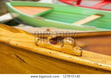 Detail of a wooden rowing boat with rowing boats on the background. Liguria Italy