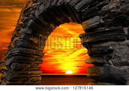 Sunset over the sea with cloudy sky seen through a stone window in Portovenere (UNESCO world heritage site) - La Spezia Liguria Italy