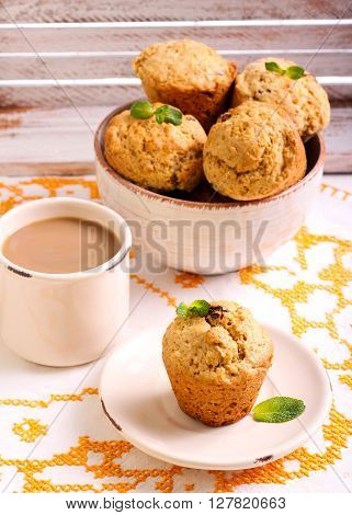 Great grain muffins with raisin served on table