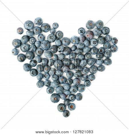 Heart shaped Ripe bilberry or blueberry composition over isolated white background