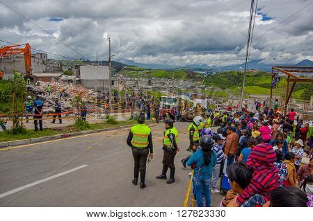 Quito, Ecuador - April, 17, 2016: House destroyed by Earthquake with rescue team and heavy machinery in the south part of the city, no casualties.