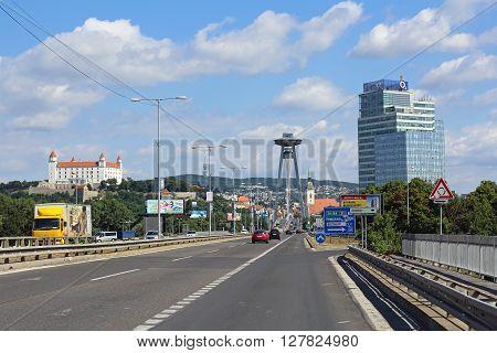 BRATISLAVA SLOVAKIA - JULY 10: SNP Bridge in Bratislava on JULY 10 2015. Famous Bratislava Bridge With UFO Restaurant on Top of Pylon in Bratislava Slovakia.