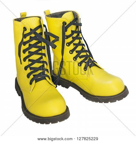 Yellow high shoes with black laces on a white background