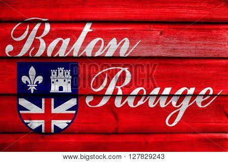 Flag Of Baton Rouge, Louisiana, Painted On Old Wood Plank Background
