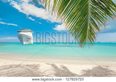 Luxury cruise ship close to tropical beach